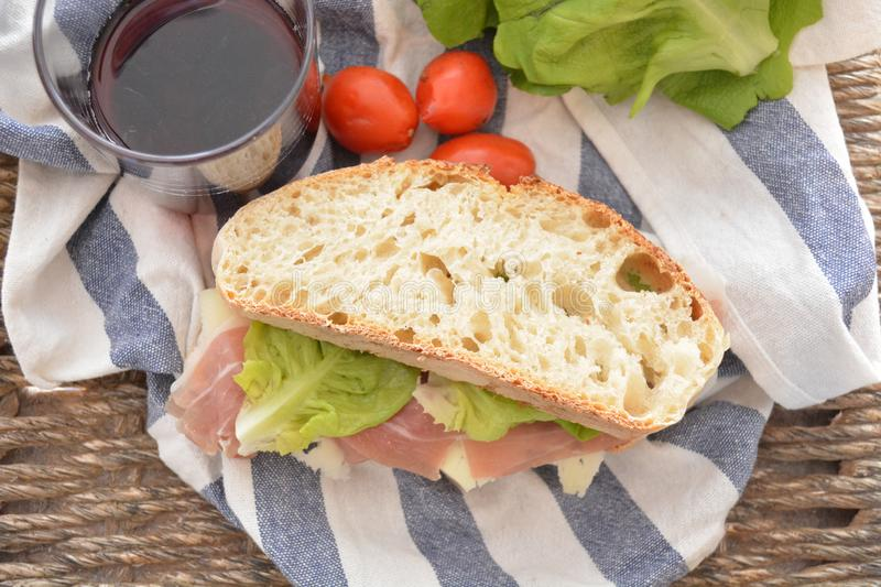 Tipical italian sandwich with cheese prosciutto of Parma lettuce leaf snack food royalty free stock photography