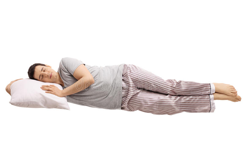 Tipo che dorme su un cuscino e su un galleggiamento fotografia stock