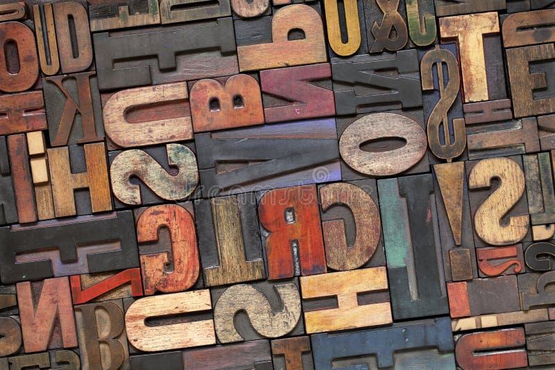 Tipo di legno dello scritto tipografico con la patina dell'inchiostro fotografia stock