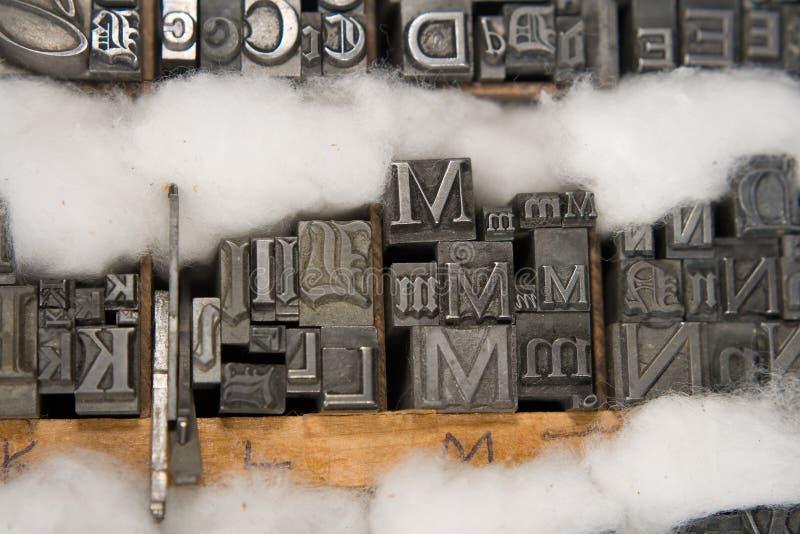 Tipo mezclado bloques de la prensa de copiar fotografía de archivo