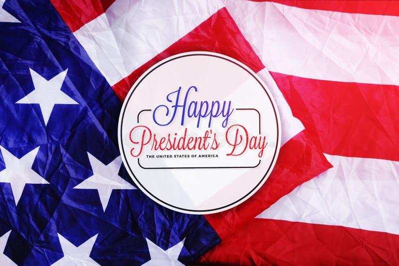 Tipografia felice di giorno del ` s di presidente sulla bandiera di U.S.A. illustrazione vettoriale