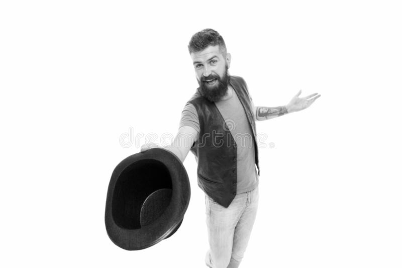 Tipping his hat as a salutation. Cheerful man greeting with hat. Bearded hipster in casual attire holding classic black. Hat. His hat etiquette game is up to royalty free stock photography