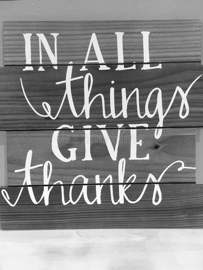 Tips in all things give thanks print on wood wall. Tips in all things give thanks, black and white picture royalty free stock photography