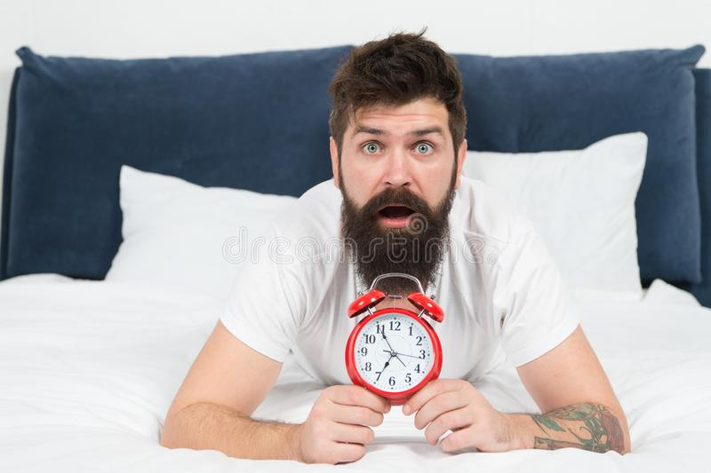 Tips for becoming an early riser. Problem with early morning awakening. Get up with alarm clock. Overslept again. Tips stock photos