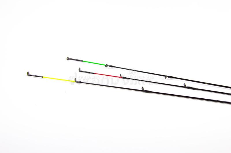 Tips of fishing rods on a white background stock photography