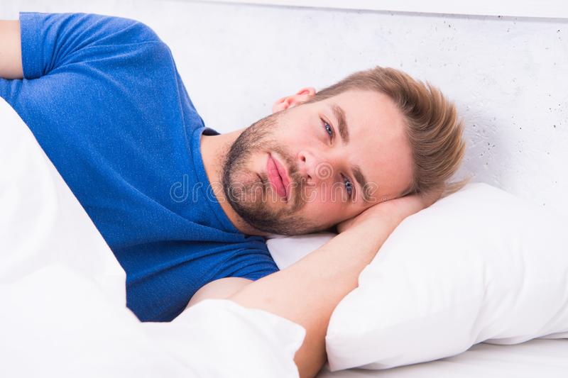Tips sleeping better. Maintaining consistent circadian rhythm is essential for general health. Man handsome guy sleeping stock photo