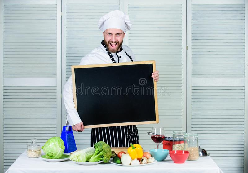 Tips to cook like pro. Check out cooking tips. Man chef hat apron hold blackboard copy space. Recipe concept. Cooking royalty free stock photography