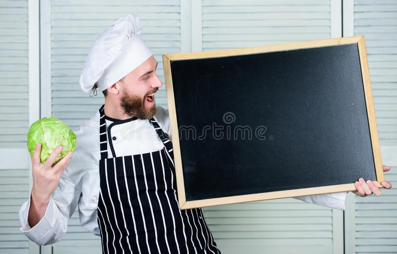 Tips to cook like pro. Man chef hat apron hold blackboard copy space. Recipe concept. Cooking delicious meal step by stock photography