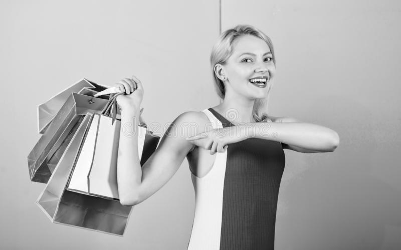 Tips to shop sales successfully. Buy everything you want. Girl satisfied with shopping. Girl enjoy shopping or just got. Birthday gifts. Woman red dress hold stock photos