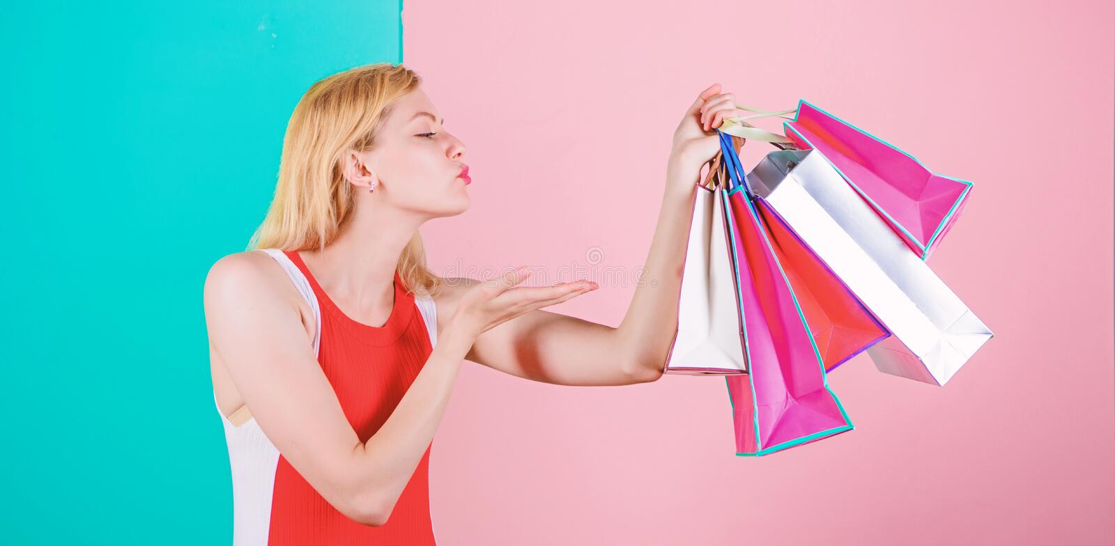 Tips to shop sales successfully. Woman red dress hold bunch shopping bags blue pink background. Girl enjoy shopping or. Just got birthday gifts. Buy everything stock image