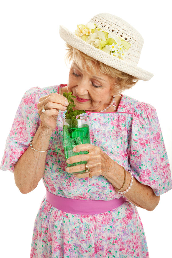 Tipsy Senior Lady Drinking Cocktail royalty free stock photography