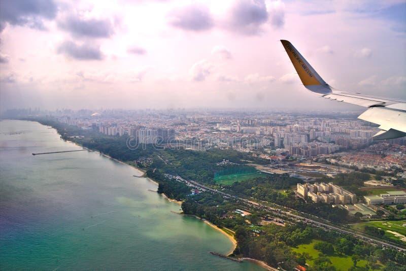 Tir aérien d'un avion de passagers de Philippines des régions côtières de Singapour avant photos libres de droits