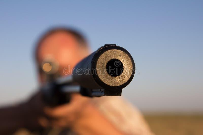 Tir avec une arme à feu photos stock