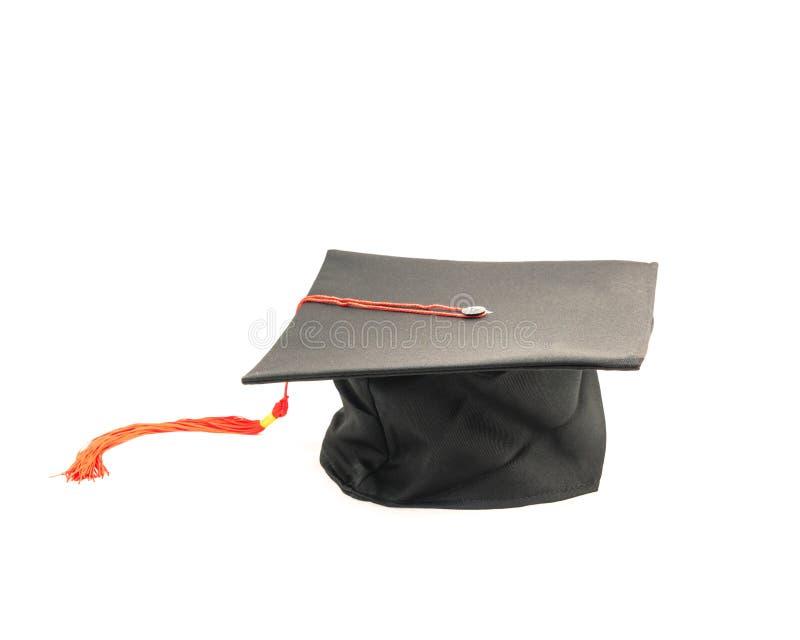Tir de studio du chapeau noir d'obtention du diplôme d'isolement sur le fond blanc photo stock