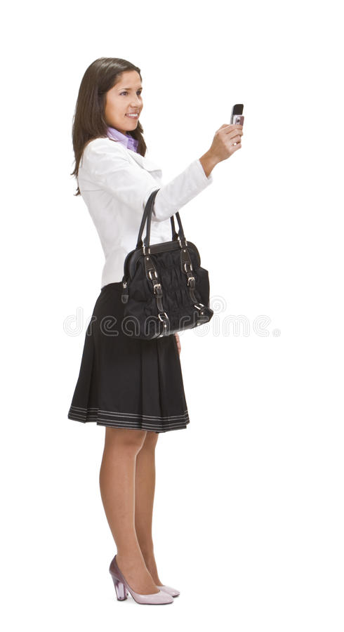 Tir femelle avec un téléphone d'appareil-photo image stock