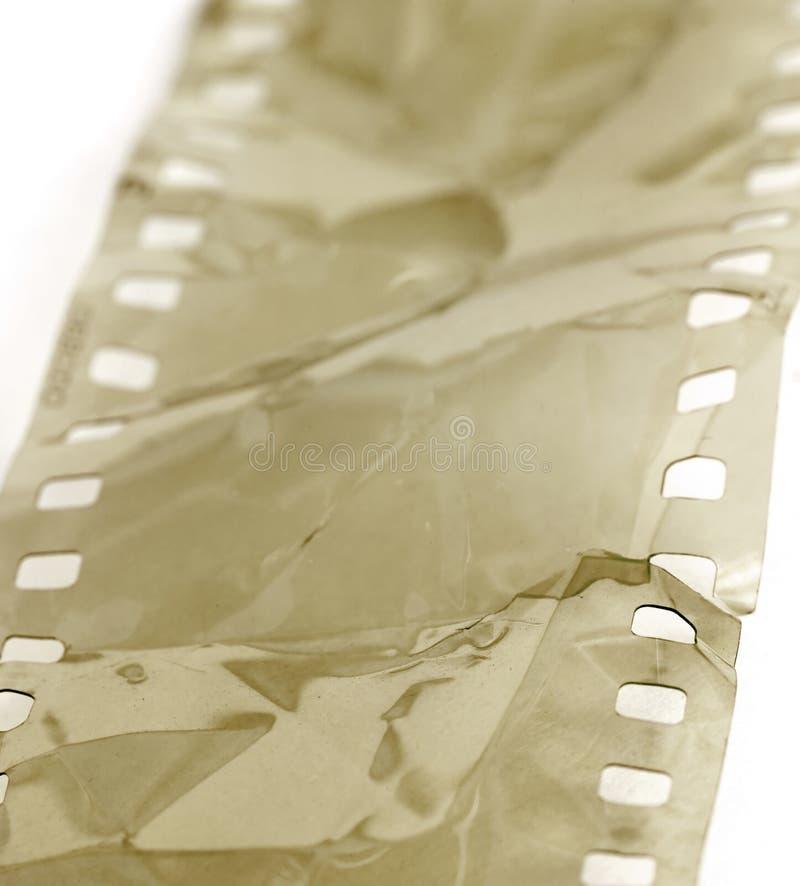 Tira danificada da película foto de stock