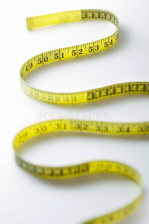 Tira de enrolamento do close-up de medição da fita imagem de stock