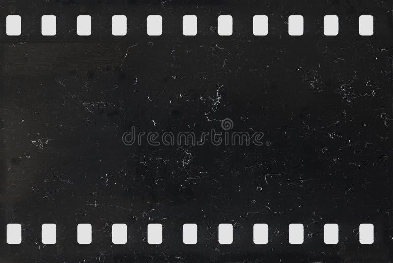 Tira do filme de celuloide negativo velho com poeira e riscos fotos de stock