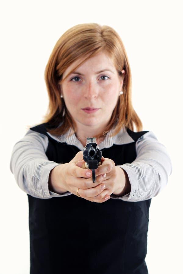 Tirado de una mujer joven que presenta con los armas imagen de archivo