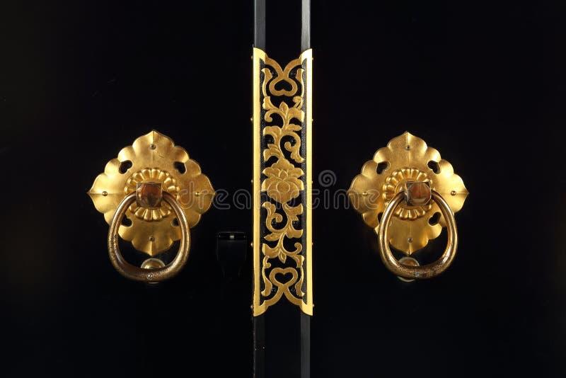 Tirador de puerta de oro japonés foto de archivo