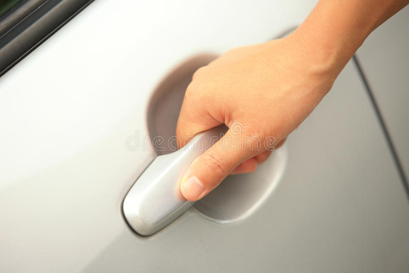 Tirador de puerta del coche del tirón de la mano foto de archivo