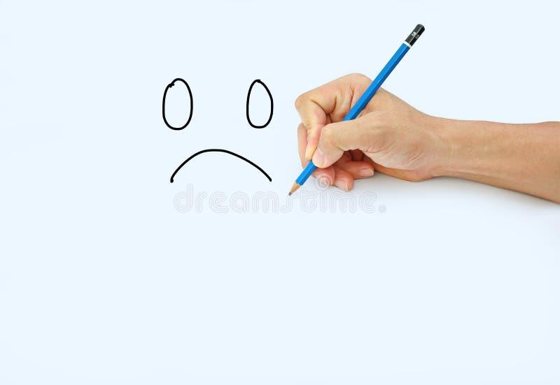 Tiragem com o lápis para a imagem de triste foto de stock