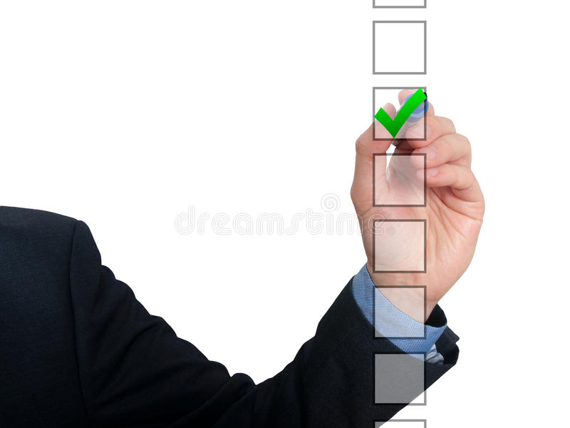 Tiraggio dell'uomo di affari con l'indicatore sull'assegno di ticchettio dello spazio vuoto della copia immagine stock libera da diritti