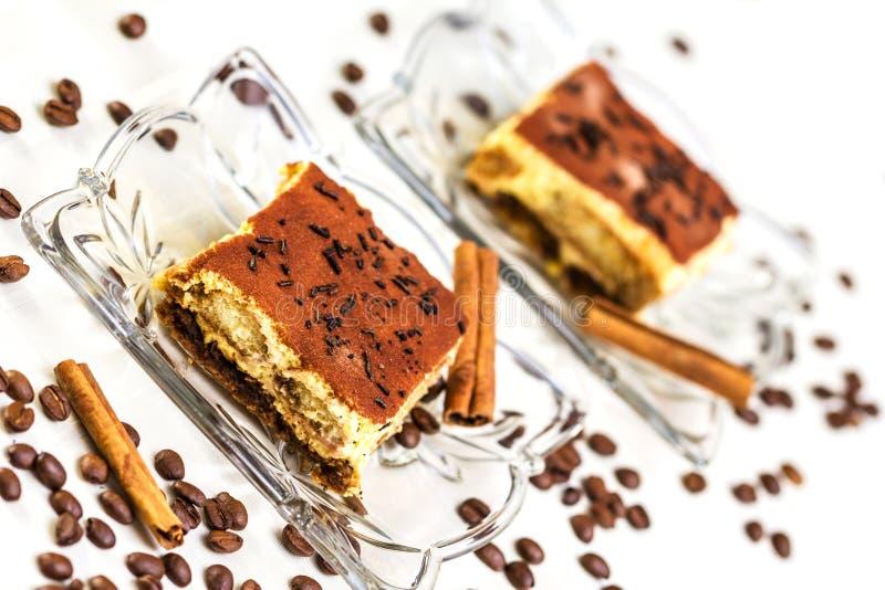 Tiramisu Cake. With coffee beans and cinnamon royalty free stock images