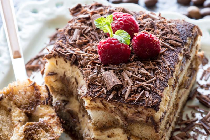 Tiramisu Cake with Grated Chocolate, Raspberry and Mint. Perfect Dessert. stock photo
