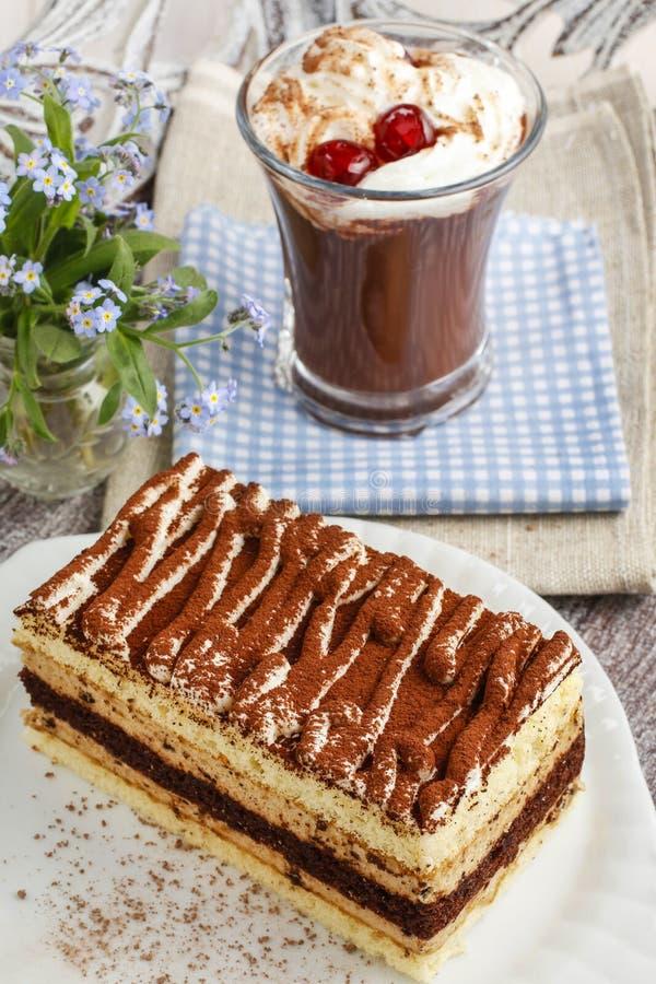Tiramisu cake and irish coffee with cherries stock photo
