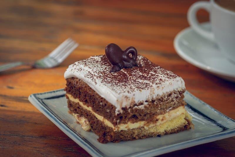 Tiramisu cake on plate and coffee cup royalty free stock photo
