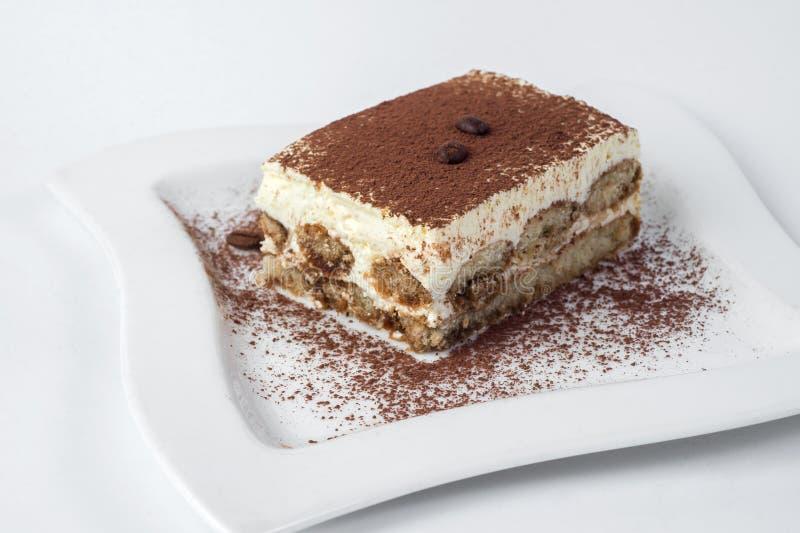 Tiramisu cake on white background royalty free stock photo