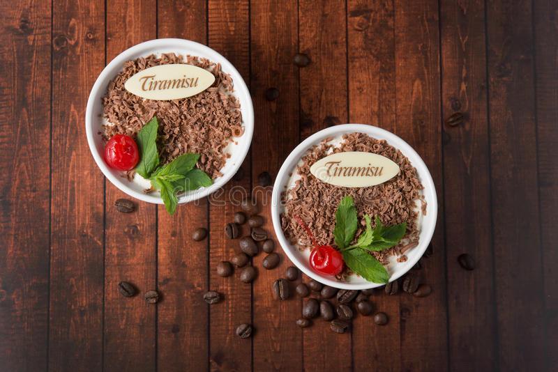 Tiramisu dessert on wooden background top view royalty free stock photos