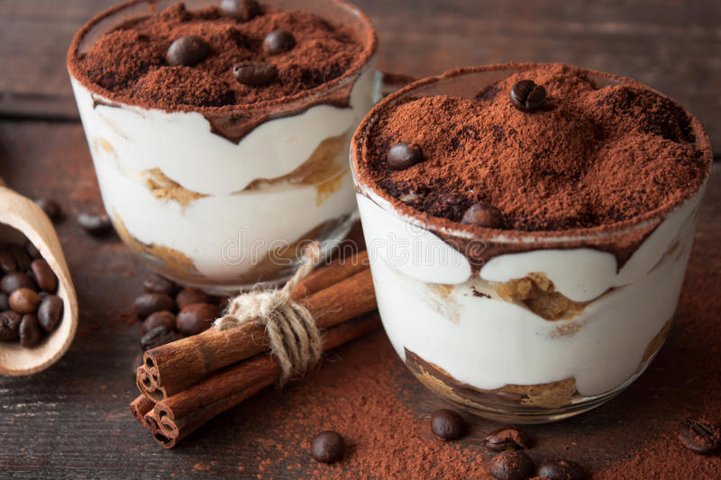 Tiramisu in a glass cup stock photography
