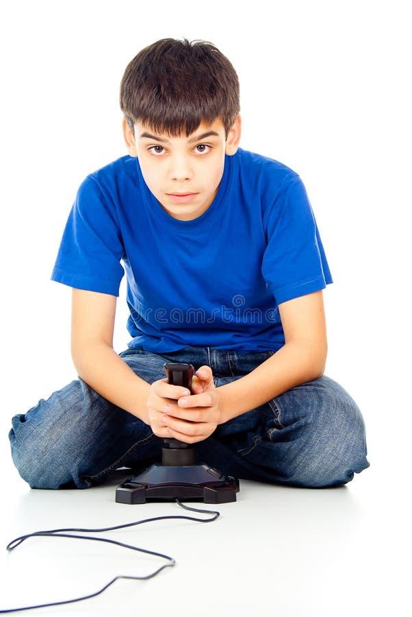 Tirante che gioca i video giochi fotografie stock