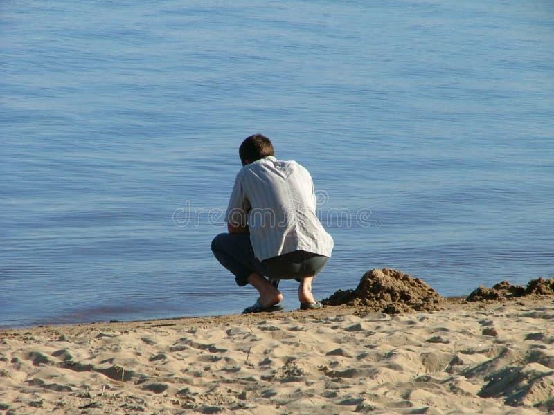 Download Tirante e la spiaggia fotografia stock. Immagine di giorno - 125672