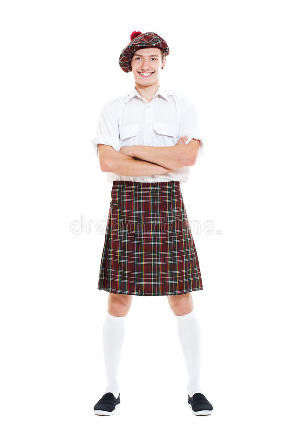 Tirante felice in vestiti scozzesi nazionali fotografia stock libera da diritti
