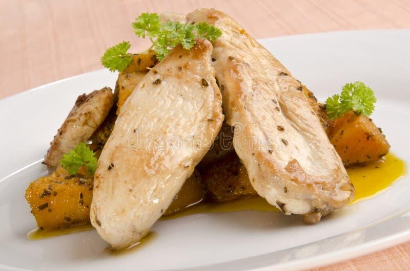 Tiras da faixa da galinha do butternut grelhado foto de stock