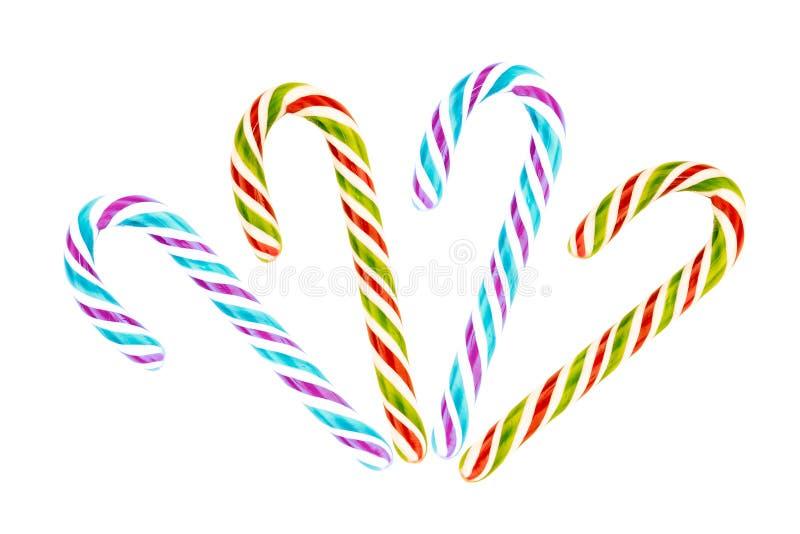 Tiras lilás azuis do bastão colorido ajustado do caramelo de pares verdes vermelhos de chocolates sobre o fundo branco fotos de stock royalty free
