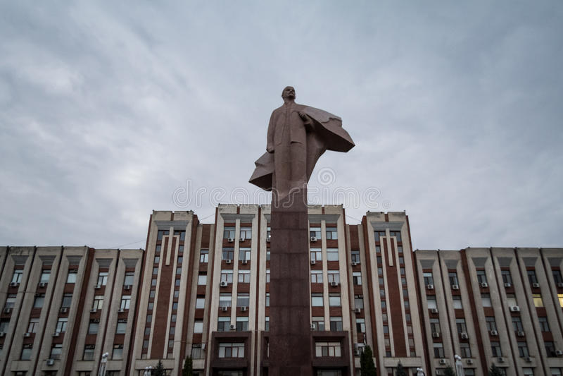 TIRASPOL, TRANSNITRIA MOLDOVA - AUGUST 12, 2016:: Transnistria Parliament building in Tiraspol with a statue of Vladimir Lenin i. Transnistria also called Trans royalty free stock photography
