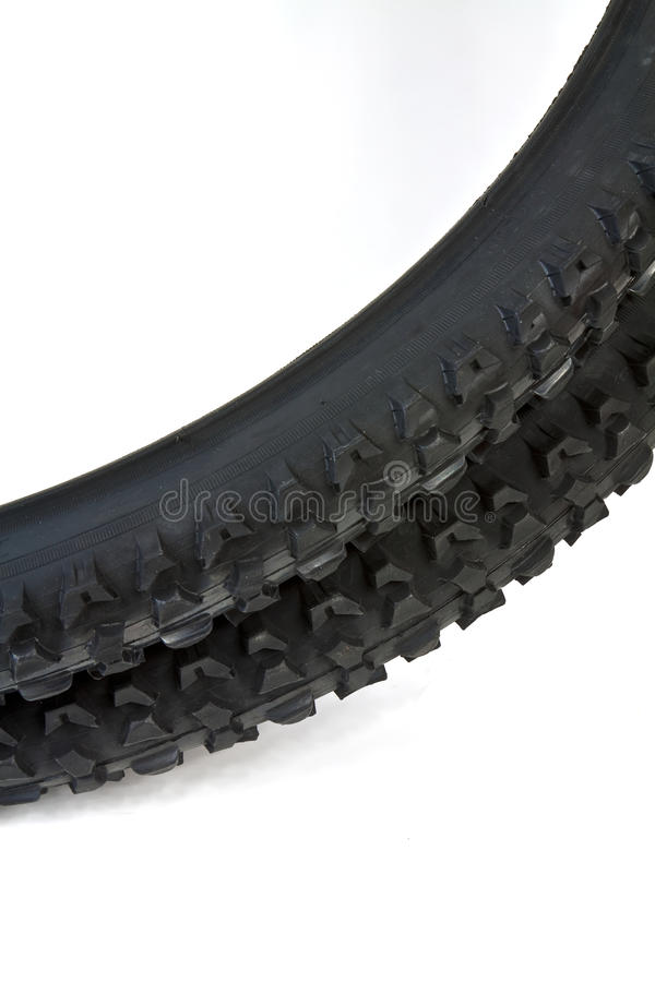 Tire for bicycle. New tire for mountain bike with distinctive tread for excellent traction royalty free stock images
