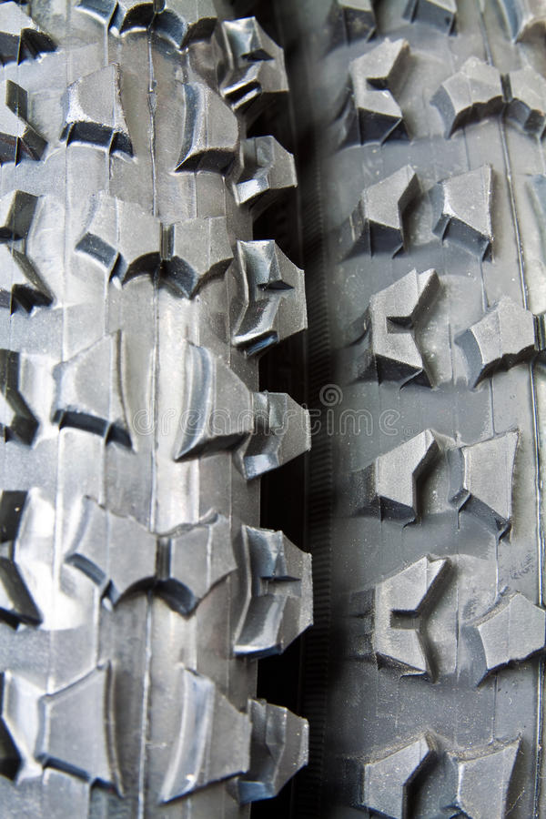 Tire for bicycle. New tire for mountain bike with distinctive tread for excellent traction stock photos