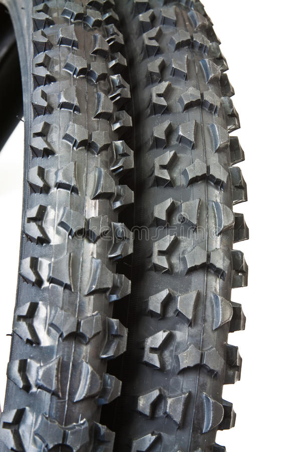 Tire for bicycle. New tire for mountain bike with distinctive tread for excellent traction stock photo