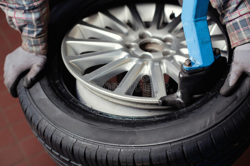Download Tire change closeup stock photo. Image of manual, maintenance - 25395840
