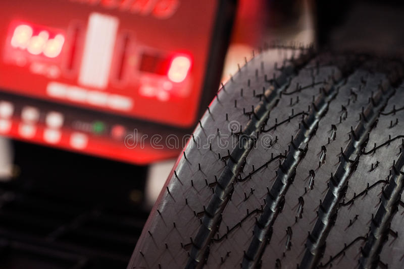 Tire check. Heavy vehicle tire check on balancing machine stock photography
