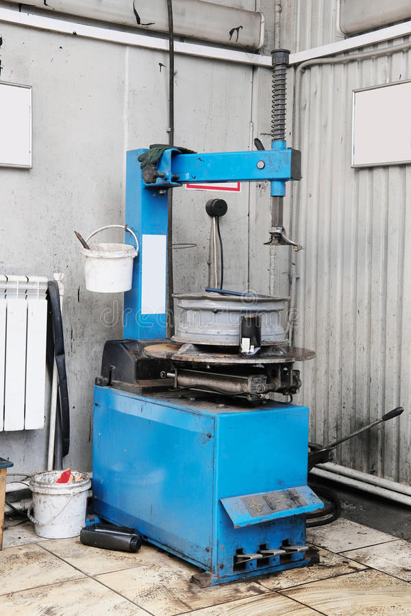Tire fitting machine. The image of a tire fitting machine royalty free stock photography