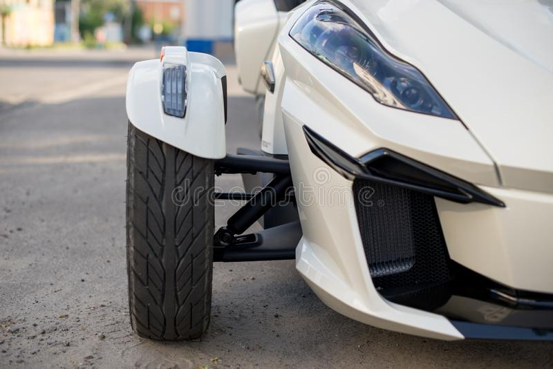 Tire and headlight for Trike or tricycle vehicle Spyder.  royalty free stock photography