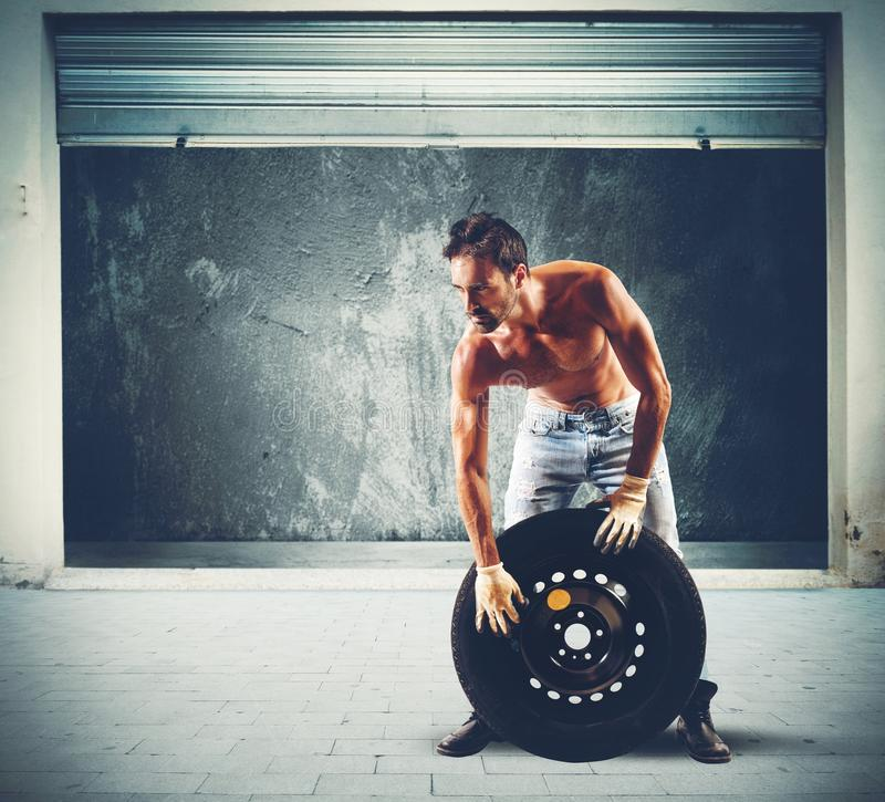 Tire repairer. Service concept with mechanic royalty free stock photo