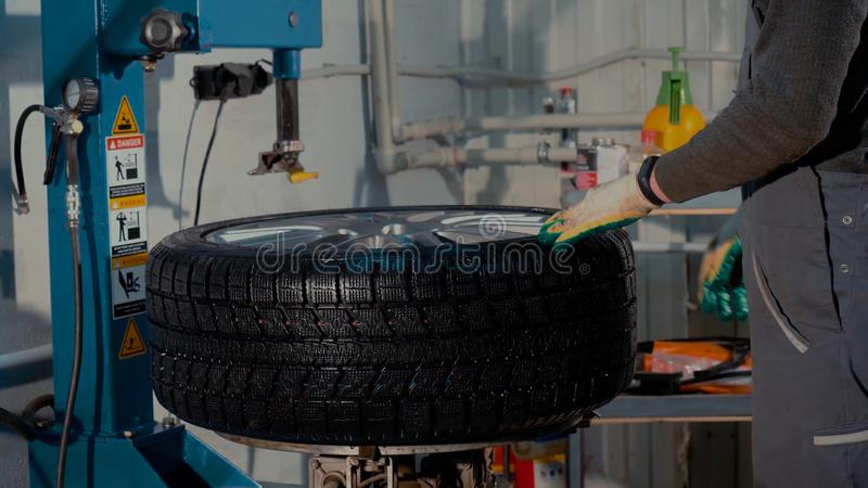 Tire replacement service, fitting with balancing, change to winter. Changing, season stock photography