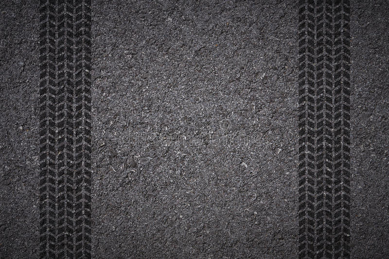 Tire track on asphalt stock photos